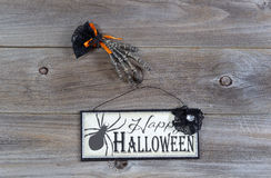 Halloween hand and sign on wood Stock Photography
