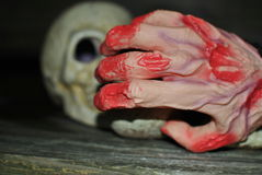 Halloween hand. Halloween skull in the dark night and hand covered in blood royalty free stock photo