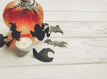 Halloween. happy halloween concept. pumpkin with witch ghost bat. S and spider black decorations on white wooden background. cutouts for autumn celebration Stock Photo