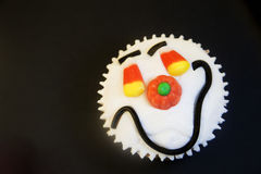 Halloween happy face cupcake Royalty Free Stock Photo