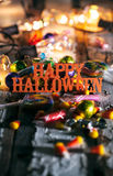 Halloween: Happy Halloween With Candy And Glowing Bulbs Stock Photos