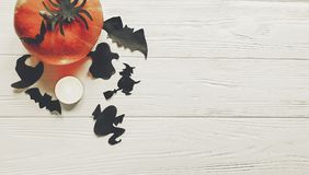 Halloween. happy halloween concept. pumpkin with witch ghost bat. S and spider black decorations on white wooden background top view with space for text Stock Image