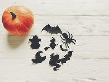Halloween. happy halloween concept. pumpkin with witch ghost bat. S and spider black decorations on white wooden background top view with space for text. cutouts Stock Images