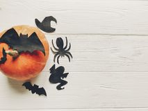 Halloween. happy halloween concept. pumpkin with witch ghost bat. S and spider black decorations on white wooden background top view with space for text Royalty Free Stock Photography