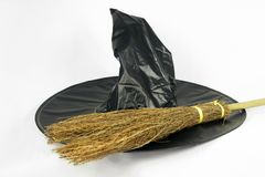 Halloween hat and broomstick Royalty Free Stock Images