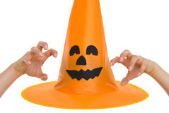 Halloween hat and scaring hand. Isolated on white Royalty Free Stock Photo