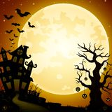 Halloween haunted castle with bats and pumpkins hanging on trees Royalty Free Stock Photos