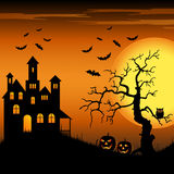 Halloween haunted castle with bats and tree backgr