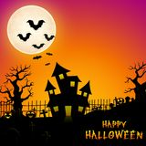 Halloween haunted castle with bats and trees in graveyard Royalty Free Stock Photo