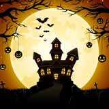Halloween haunted castle with pumpkins hanging on trees and the full moon background Royalty Free Stock Image