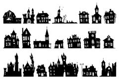 Halloween haunted house. Church and other buildings isolated on white background Stock Images
