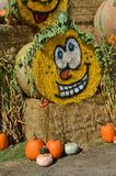 Halloween Hay Bale in Gervis, Oregon. This is a rolled hay bale at Bauman Farm in Gervis, Oregon decorated for Halloween with a pumpkin face in a display with stock images
