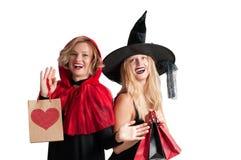 Halloween-het Winkelen Mooie meisjes in Halloween-kostuum Stock Afbeelding
