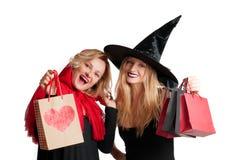 Halloween-het Winkelen Mooie meisjes in Halloween-kostuum Stock Foto