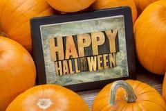 Halloween heureux sur le comprimé Photos stock