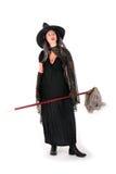 Halloween-Hexe mit Mopp Stockfoto