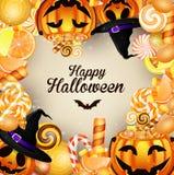 Halloween-Hintergrund mit Kürbisen und Süßigkeiten Stockfoto