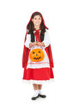 Halloween: Holding Pumpkin Bucket for Treats. Halloween series with cute children dressed as Dracula, a pirate, and Little Red Riding Hood.  Isolated on white Royalty Free Stock Photos