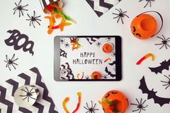 Halloween holiday background with digital tablet Stock Photo