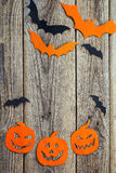 Halloween holiday background with Jack-o'-Lanterns and bats cu Stock Photo