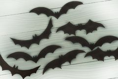 Halloween holiday background with many different black flying bats stock image