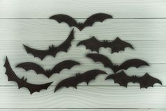 Halloween holiday background with many different black flying bats royalty free stock photo