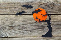 Halloween holiday background with moon, tree and bats cut paper Royalty Free Stock Image