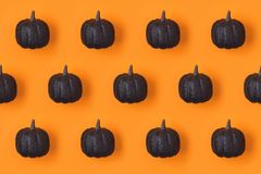 Halloween holiday background pattern with glitter  pumpkin decor Royalty Free Stock Photos