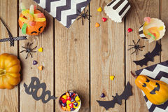 Halloween holiday background with pumpkin and candy. Royalty Free Stock Photos
