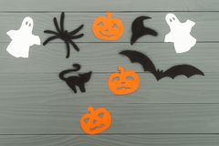 Halloween holiday background with three pumpkins, cat, spider, bat, hat and two ghosts Stock Photography