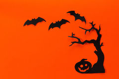 Halloween holiday background with tree, pumpkin and bats cut bla Stock Photos