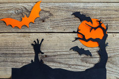 Halloween holiday background with zombies hand, tree and bats cu Royalty Free Stock Image