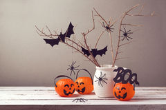 Halloween holiday celebration with spiders and pumpkin buckets Stock Images