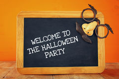 Halloween holiday concept. Blackboard with funny mask Royalty Free Stock Images