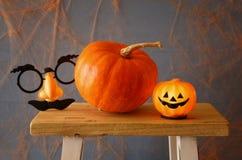Halloween holiday concept. Cute pumpkin on wooden table Stock Photos