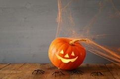 Halloween holiday concept. Cute pumpkin on wooden table Royalty Free Stock Photos
