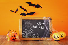 Halloween holiday concept. Cute pumpkins next to blackboard Royalty Free Stock Photography