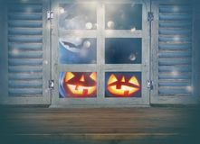 Halloween holiday concept. Empty rustic table in front of haunted night sky background and old window. Ready for product display m. Ontage stock images