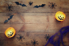 Halloween holiday concept top view. Pumpkins, spiders, bats Royalty Free Stock Images