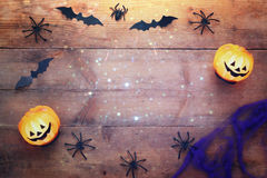 Halloween holiday concept top view. Pumpkins, spiders, bats Royalty Free Stock Photos