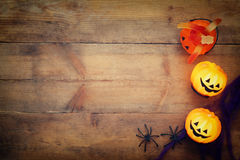Halloween holiday concept top view. Pumpkins, spiders. On wooden old table royalty free stock photography