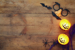 Halloween holiday concept top view. Pumpkins, spiders Stock Photos