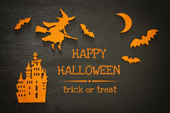 Halloween holiday concept top view scene. Old castle, witch, bats on wooden black bachground Royalty Free Stock Photos