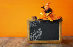 Halloween holiday concept. Witch hat, and blackboard Stock Photos