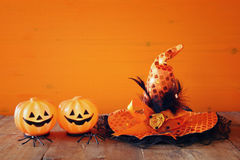 Halloween holiday concept. Witch hat, cute pumpkins Stock Photos