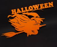 Halloween holiday metal top view image of orange witch over black background vector illustration