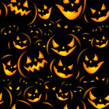 Halloween holiday, seamless background. Seamless Halloween background with the terrible pumpkins coming from darkness Royalty Free Stock Photo