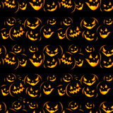 Halloween holiday, seamless background. Seamless Halloween background with the terrible pumpkins coming from darkness Stock Images