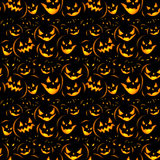 Halloween holiday, seamless background. Seamless Halloween background with the terrible pumpkins coming from darkness Royalty Free Stock Photos