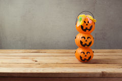 Halloween holiday trick or treat candy with jack o lantern bucket on wooden table Royalty Free Stock Images